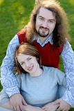 Young couple sitting on the grass in a park Stock Image