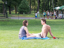 Young couple sitting at the Great Lawn at Central Park in New Yo Stock Photo