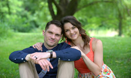 Young couple sitting on the ground Stock Photography