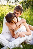 Young couple sitting on ground in park Royalty Free Stock Photos