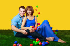 Young couple sitting on lawn Royalty Free Stock Photos