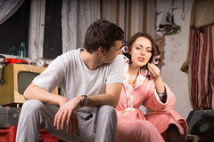Young Couple Sitting at the Messy Room Stock Image