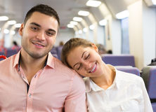 Young couple sitting in modern train Royalty Free Stock Photos