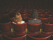 Young couple sitting in movie theater Stock Photos