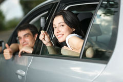 Young couple sitting in the new car Royalty Free Stock Photo