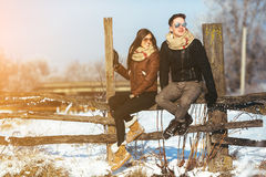 Young couple sitting on old fence Royalty Free Stock Photography
