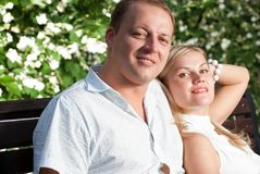 Young couple sitting in park Royalty Free Stock Images