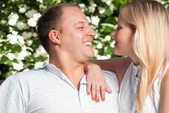 Young couple sitting in park Stock Images