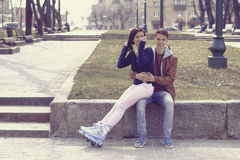 Young couple sitting in the park. stock images