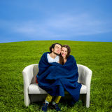 Young couple sitting and relaxing on the couch   Stock Photography