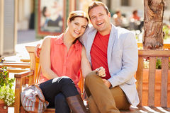 Young Couple Sitting On Seat In Mall Together Stock Photography