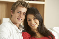 Young Couple Sitting On Sofa Stock Image
