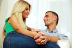 Young couple sitting on the sofa Stock Image