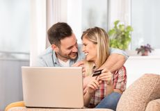 Young couple shopping online at home Royalty Free Stock Photography