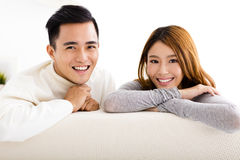 young couple sitting in sofa royalty free stock images