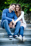 Young couple sitting on the stairs Stock Photos