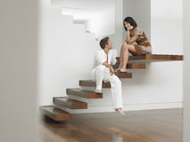 Young Couple Sitting On Stairs Stock Image