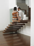 Young Couple Sitting On Stairs Royalty Free Stock Photos