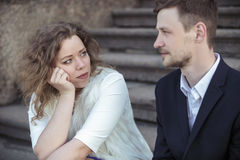 Young couple sitting on stairs on the street royalty free stock photos
