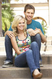 Young Couple Sitting On Steps Of Building Royalty Free Stock Photo
