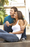 Young Couple Sitting On Steps Of Building Stock Photography