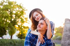 Young couple sitting on a stone wall royalty free stock photos