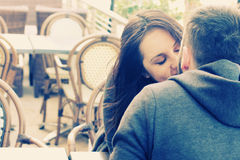 Young couple sitting in street cafe Royalty Free Stock Images