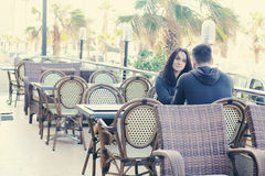 Young couple sitting in street cafe Stock Photo