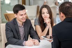 Young couple sitting at a table and solve theirs problems with a Stock Photography