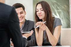 Young couple sitting at a table and solve theirs problems with a Stock Image