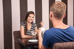 Young couple sitting and talking in cafe. stock images