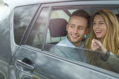 Young couple sitting in a taxi Royalty Free Stock Images