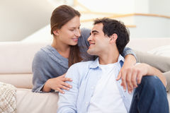 Young couple sitting in their living room Stock Photos