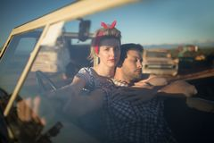 Couple sitting together in a car Royalty Free Stock Images