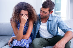 Young couple sitting together and discussing after a fight royalty free stock photo