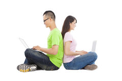 Young  couple sitting together with laptop Stock Images