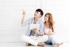 Young couple sitting together and looking up. Relaxed young couple sitting together and looking up Stock Images