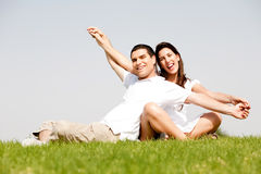 Young Couple Sitting Together Outside royalty free stock photography