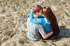 Young couple sitting together in park Royalty Free Stock Photo