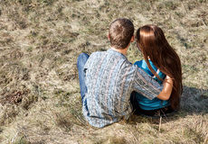 Young couple sitting together in park Stock Images