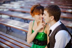 Young couple sitting together on park bench Stock Image