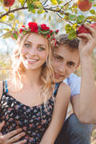 Young couple sitting under apple-tree in the Stock Image