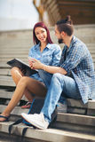 Young couple sitting at university campus Stock Photography
