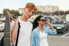 Young Couple With Skateboard Having Fun At City Street royalty free stock photo