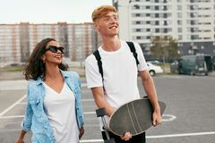 Young Couple With Skateboard Having Fun At City Street royalty free stock images