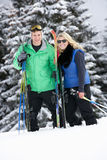 Young Couple On Ski Holiday In Mountains Stock Image
