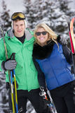 Young Couple On Ski Holiday In Mountains Stock Photo