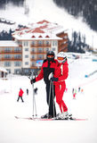 Young couple on a ski slope Royalty Free Stock Image