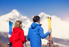 Young couple skiing Stock Photography