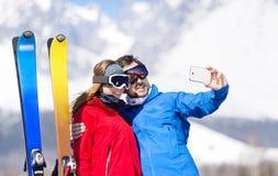 Young couple skiing Stock Photo